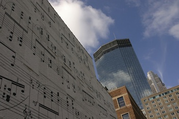 City buildings with musical notation