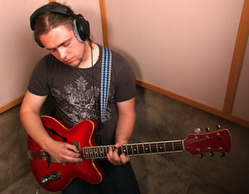 Guitarist with headphones