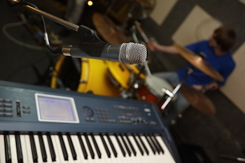 Synth keyboard/band rehearsal