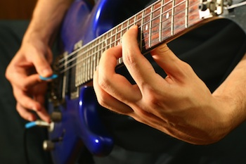 Guitarist playing chords