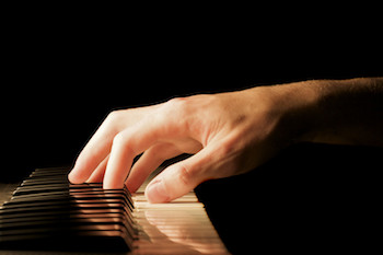 Pianist playing a chord