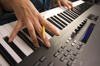 Songwriter working at a piano keyboard