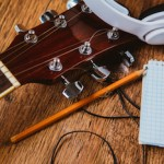 Guitar and paper - Songwriting