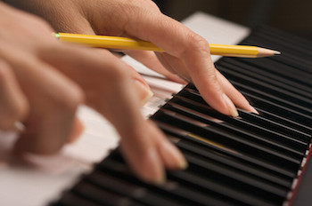 Songwriter at piano