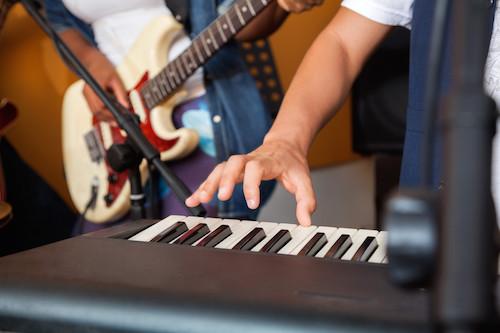 Piano keyboard and guitar