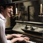 Singer - songwriter at the piano