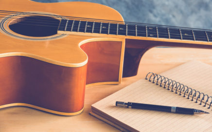 Guitar and paper for songwriting