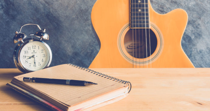 Guitar and Notepad - Songwriting schedule
