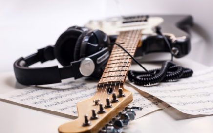 Guitar, headphones and music