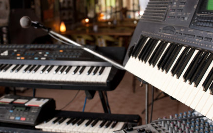 synthesizer keyboards on stage